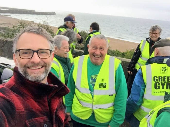 happy smiling people beach sea work yellow vest green gym man beard glasses
