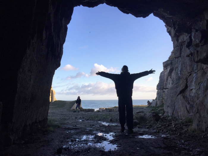 person open arms cave sky sea