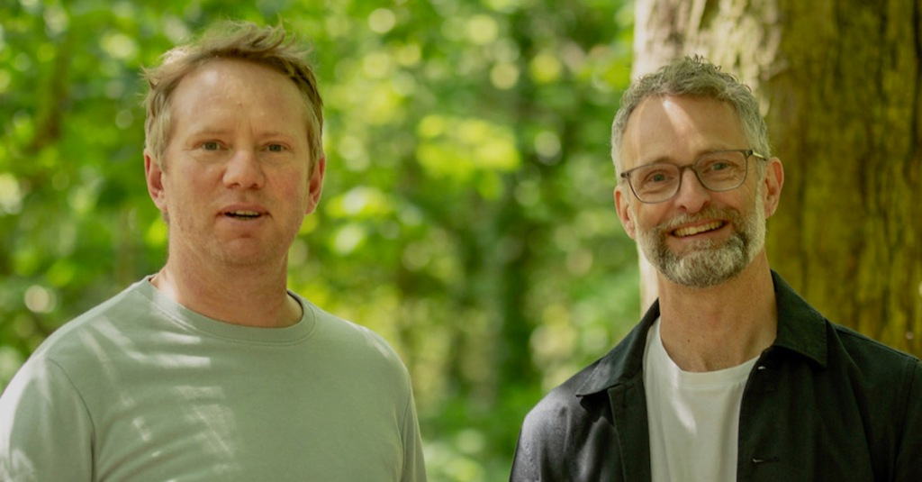 two men in woodland smiling